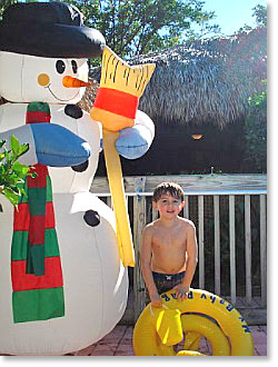 Aiden with snowman in Florida
